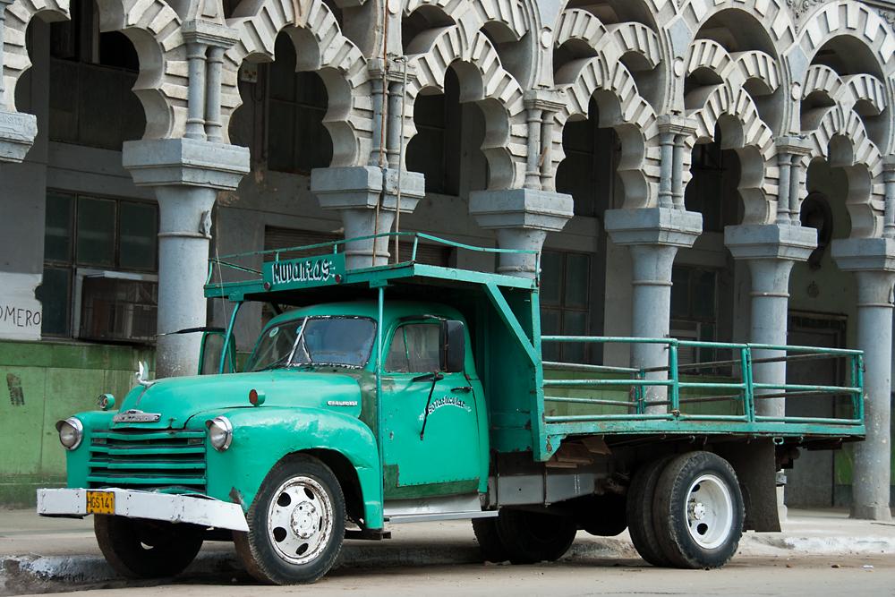 truck in front of moorish building